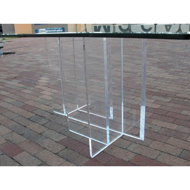 Intricate labyrinth shaped lucite base writing/dining table. 1 inch bevel glass top. Small chip in one corner (not...