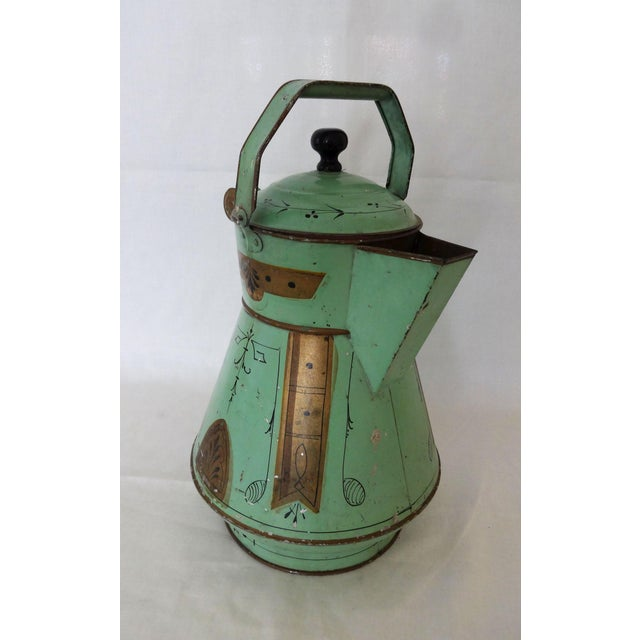 Late 19th Century Toleware water kettle, painted in a celadon green color with a unique antiqued gold and black design....