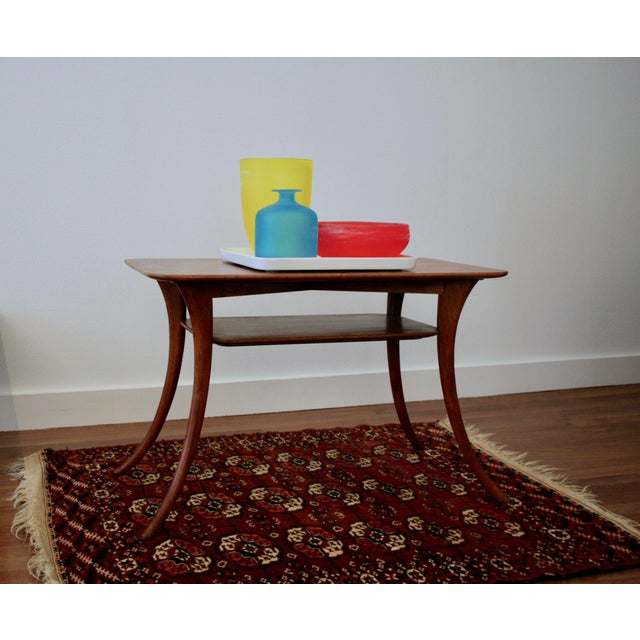 A rare, walnut Klismos sabre leg table by T.H. Robsjohn-Gibbings, model 3328, produced in the United States in 1954....