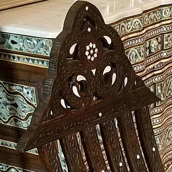This is a gorgeous Moroccan / Syrian style walnut wood inlaid chair with a touch of mother-of-pearl. Made out of natural...