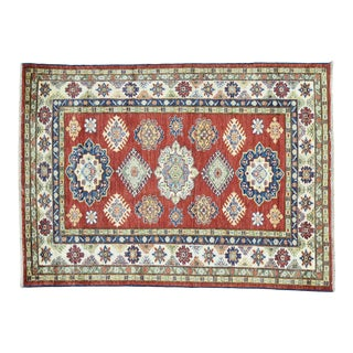 Hand-Knotted Tribal Design Red Kazak Rug- 4′1″ × 5′7″ For Sale