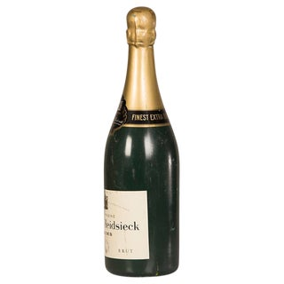 "An enormous replica bottle of champagne labeled ""Charles Heidseck"" from France c.1940."