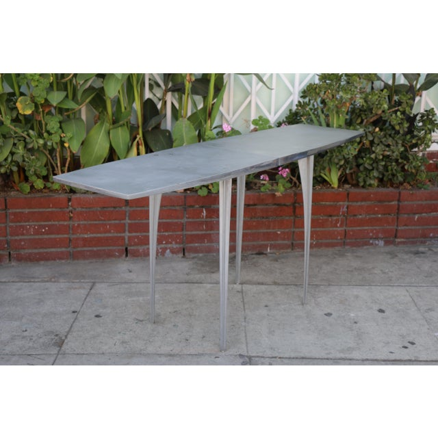 Vintage aluminum console table in good working condition. Legs screw off, also very sturdy.