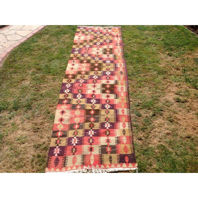 This beautiful, vintage handwoven kilim runner is approximately 60 years old. It is handmade of very fine quality wool and...