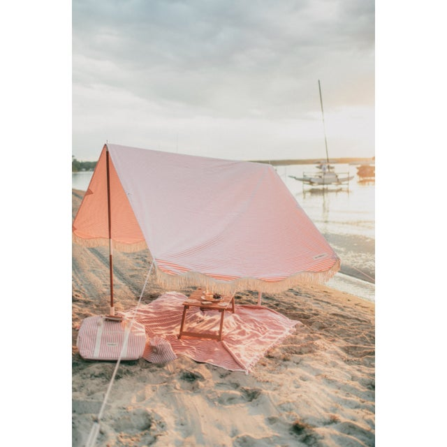 """Classic lines, this pink and white striped number is a timeless, nautical piece for decades to come. Our Premium Tent..."