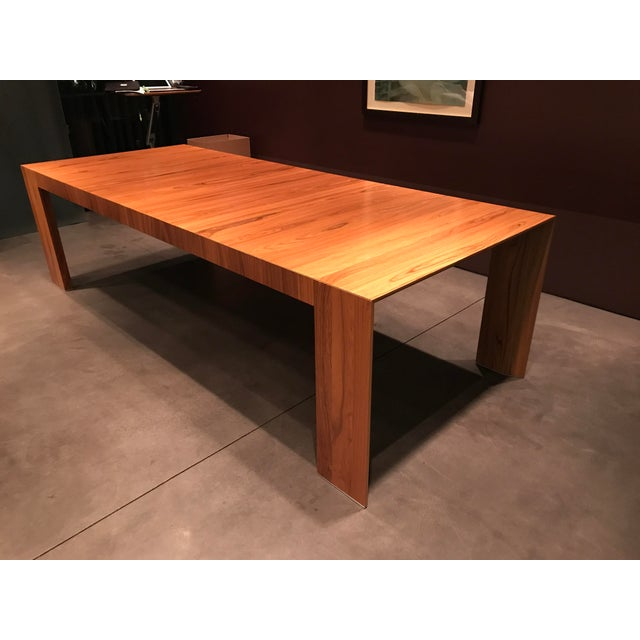 Beautiful Hannes Wettstein 370 EL DOM dining table for Cassina in lush santos rosewood. The table can be dismantled....