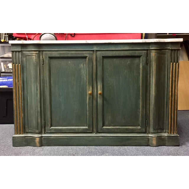 Rich green/blue painted console table with an antiqued finish. Topped with a gorgeous notched marble. Gold accents on...