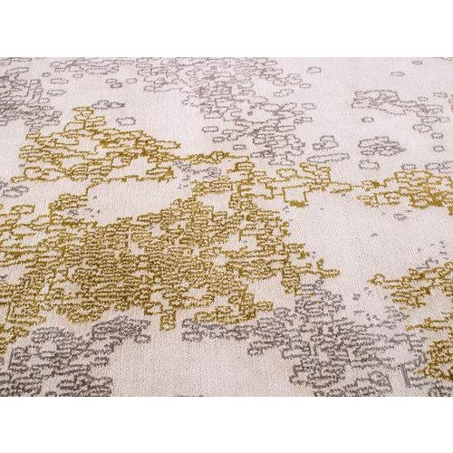 Gold and steel-colored fragments create the ethereal mood of Seychelles. The natural white background, woven in a wool...