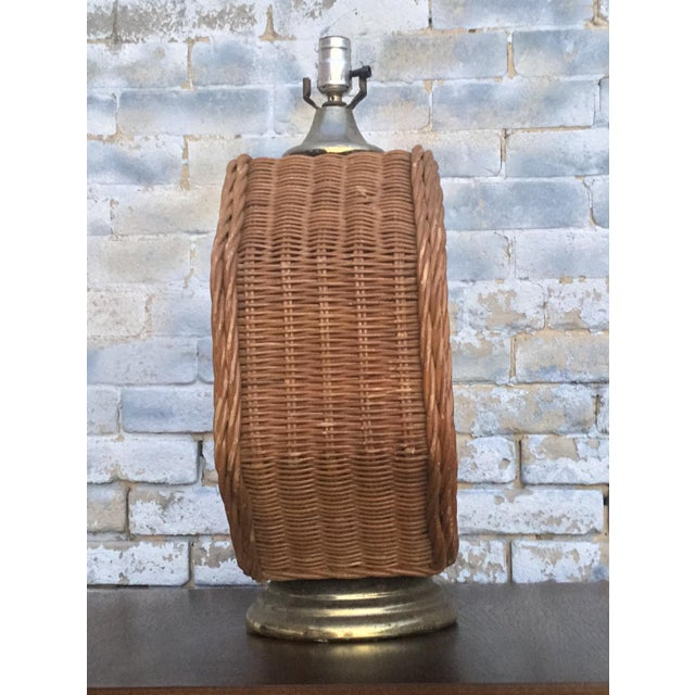 Vintage Octagonal Wicker Lamp with a Gold Metal Base. This piece would look great in a Boho Chic room.