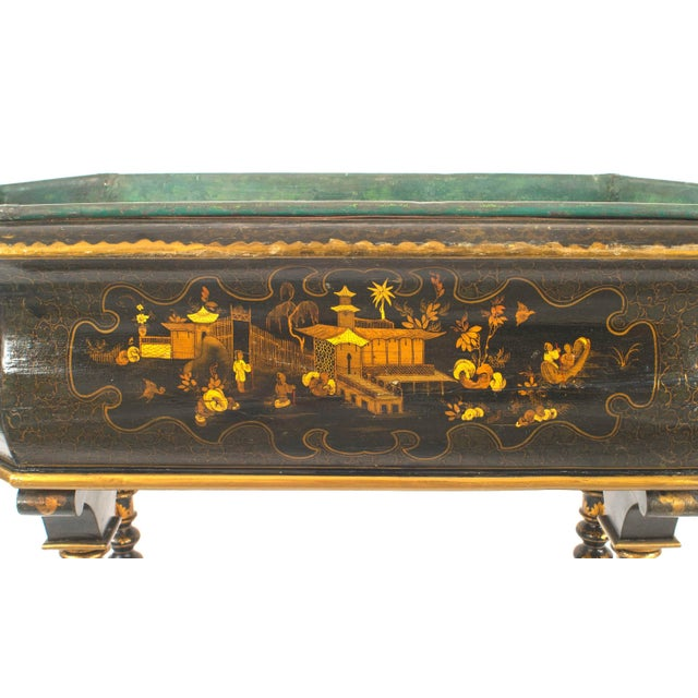 English Queen Anne style gilt and black lacquered Chinoiserie decorated fernery of bombe form on turned legs joined by a...