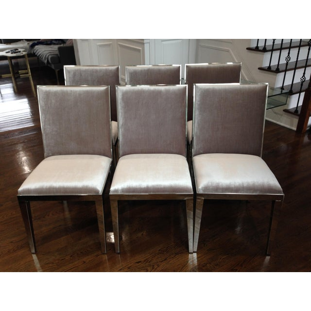 Set of 6 beautiful modern dining chairs with grey velvet upholstery and chrome frame. Adds a glamorous touch to any dining...