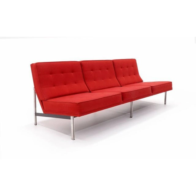 Florence Knoll three-seat parallel bar sofa without arms. Newer, striking red wool fabric. Very good condition.