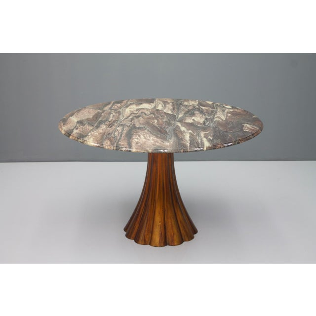 A fantastic Marble Table with a waved cast metal base and a spectacular marble top. Attributed to Angelo Mangiarotti...