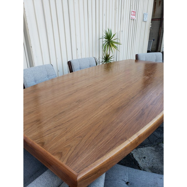 Vintage, solid walnut dining or conference table. It features solid wood construction and beautiful walnut to the table...