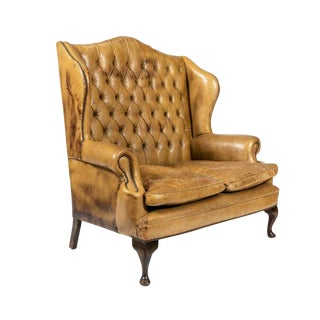 Tufted Leather Wingback Loveseat in the Style of Chippendale For Sale