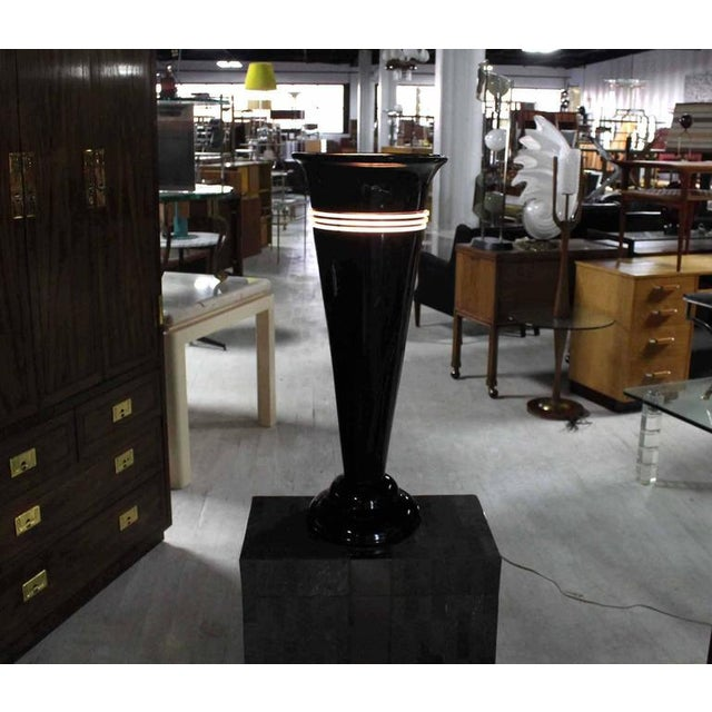 """Pair of cone urn shape black lamps made out of backligt like material . Measures: 30""""."""