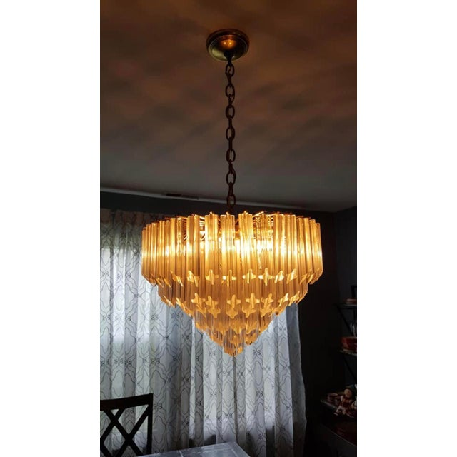 """For sale is a nice dining room Murano glass chandelier. Includes 110 prisms that are 6"""" length. Gold brass skeleton frame..."""