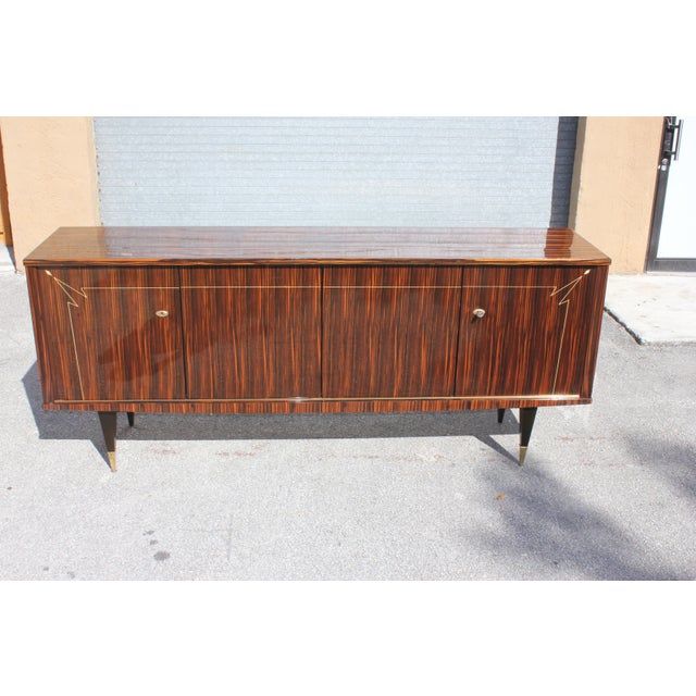 Beautiful French Art Deco exotic Macassar ebony diamond mother of pearl sideboard/buffet, circa 1940s. The sideboard are...