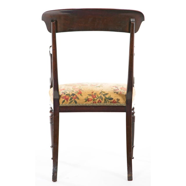 Offering this French mahogany armchair, circa 1840.