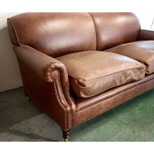 Luxurious chocolate brown soft leather George Smith three seater standard arm signature sofa. Handmade in England and of...