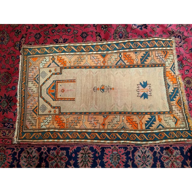 Beauty in Simplicity! That is what this small prayer rug from NW Persia should be called. The camelhair field of the rug...