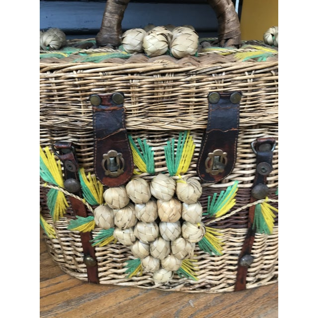 This charming picnic basket has lovely grape details and hand done yarn details. Perfect for a basket collection or decor.