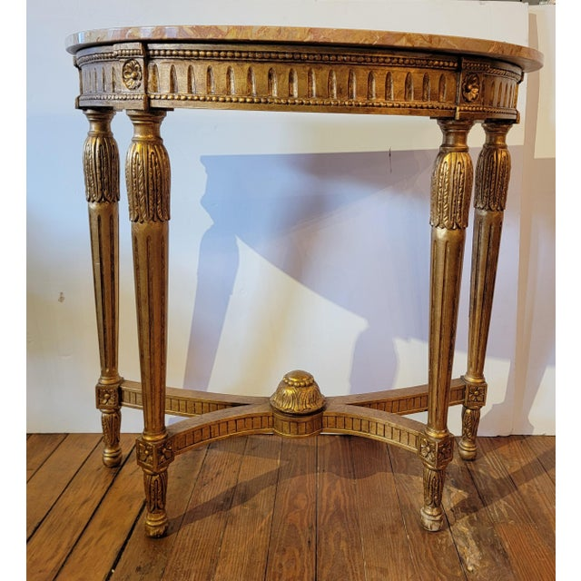 Absolutely gorgeous giltwood demi-lune with French red marble top from suite 35F of the historic Waldorf Astoria hotel in...