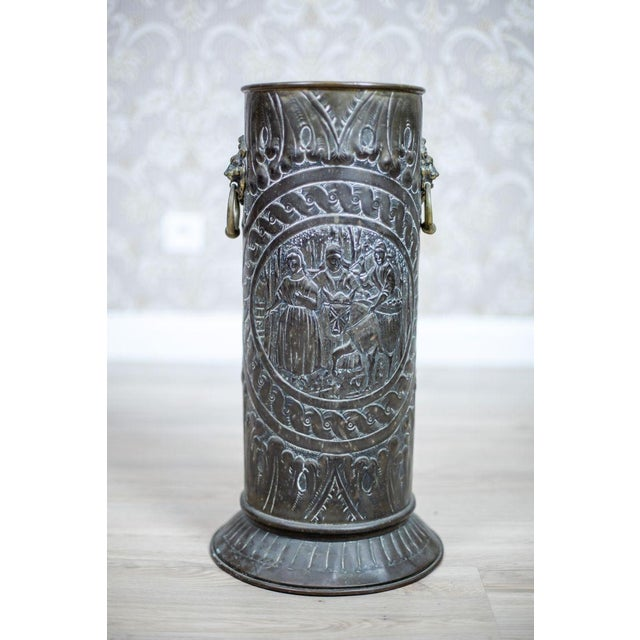 We present you a cylindrical umbrella stand with two handles on the sides. The surface is covered with an embossed...