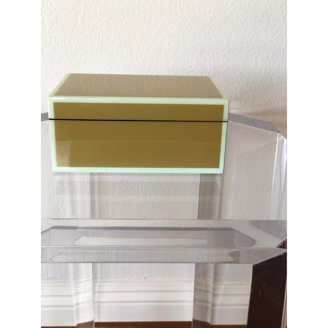 Medium hand-crafted green and duck egg blue lacquer box, complete with velvet interior base. This piece was made by...