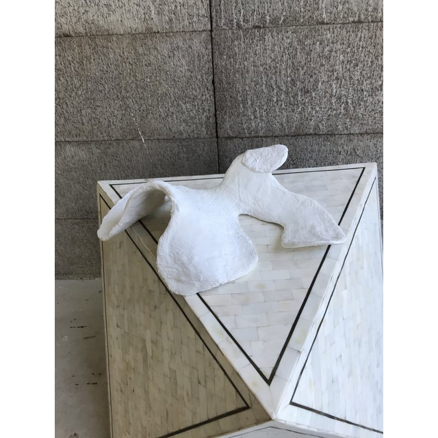 Plaster, fabric, and other mixed media have been shaped to create a composition that strikes me as organic, alien, and...