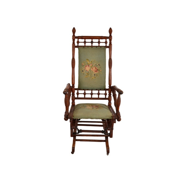 Rocking Chair from the 17th Century, hand carved with turned wood details on 2 Casters. Sturdy and comfortable crafted...