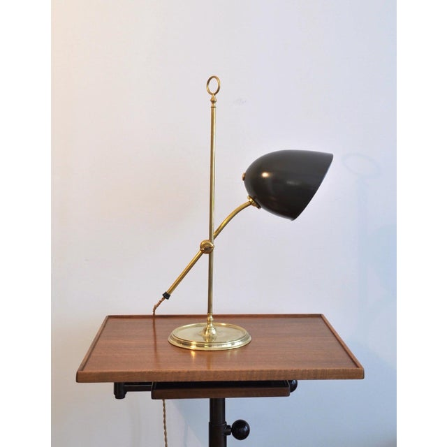 Transitional desk lamp designed and manufactured by the Swiss power house bronze bronze work shop, BAG TURGI, Switzerland....