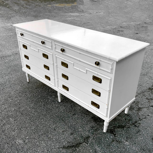 Vintage Ficks Reed dresser with brass hardware and faux bamboo trim detail and legs. Features 2 smaller drawers on top and...