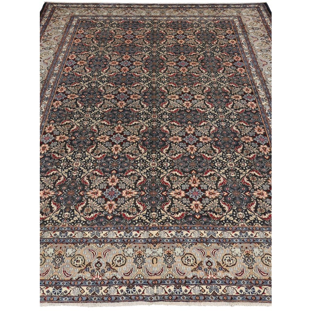 An excellent representation of Persian culture, this captivating vintage Persian Mashhad rug with modern traditional style...