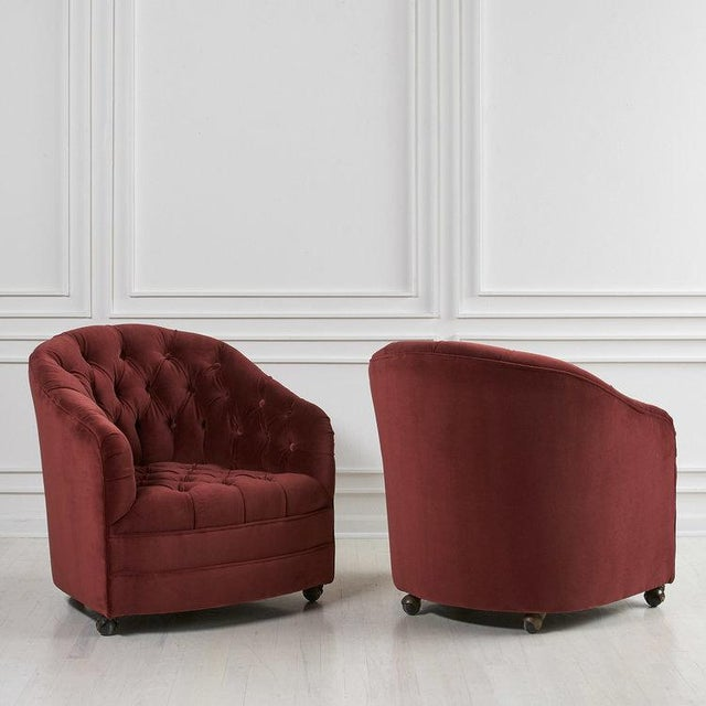 A beautiful pair of tufted swivel chair, restored and featured in a deep bordeaux velvet. In the style of Ward Bennet,...