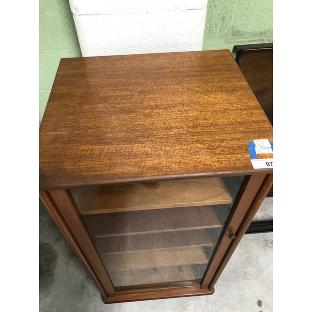 Fantastic Rolling Mid Century Modern Cabinet With Glass Door, 4 Adjustable Horizontal Shelves, and 4 Vertical Bottom Shelves.