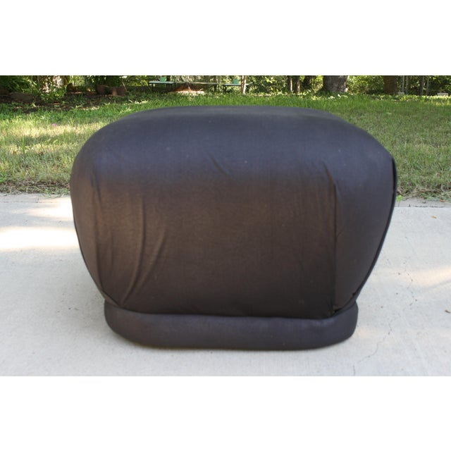 This vintage, Karl Springer style soufflé pouf/ottoman comes on hidden rollers and would be amazing reupholstered in...