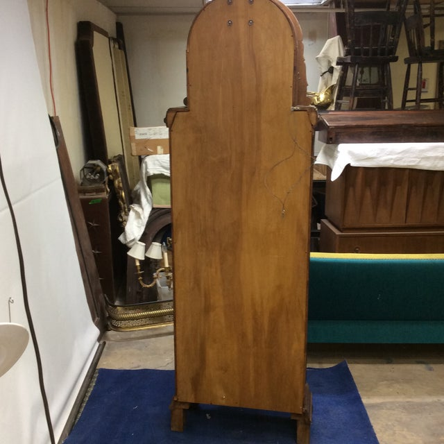 This grandfather clock was originally purchased in Germany and the clockworks are made by A. Kieninger, there is his name...