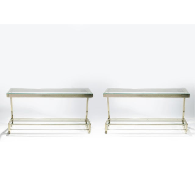 Minimalistic lines become lighter than air in this 1970s pair of console tables. Crafted by Guy Lefevre for Maison Jansen,...