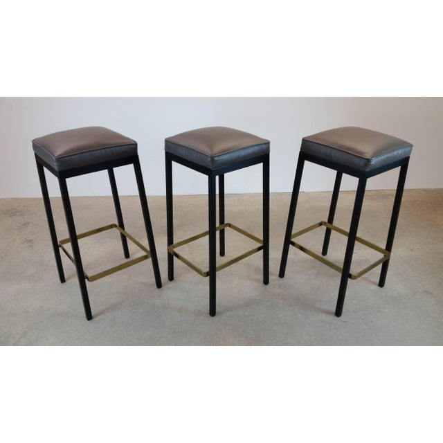 Bar stools designed by Florence Knoll, and produced by Knoll Associates, circa 1952. Tops newly upholstered in top quality...