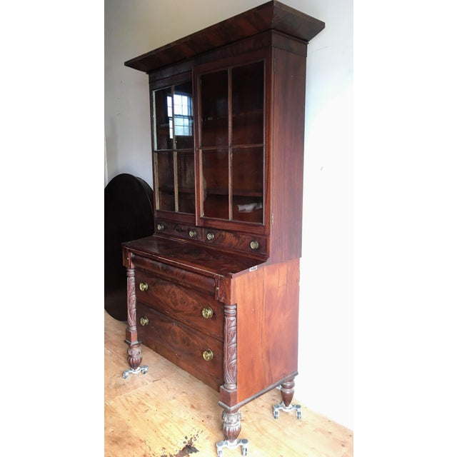 Elegant American Empire three piece secretary desk with beautiful glass doors, carved half columns, and turned bun feet....