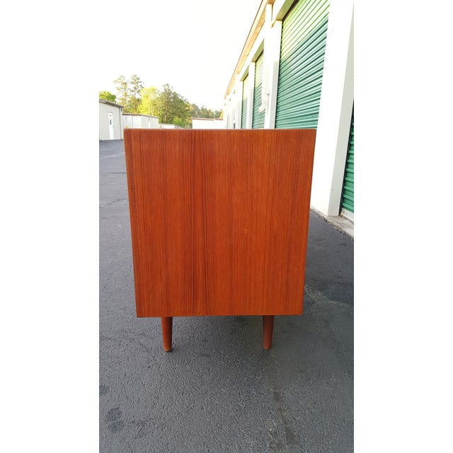 This beautiful Danish modern teak credenza is in the style of Arne Vodder with the eye shaped/arched sculpted drawers....