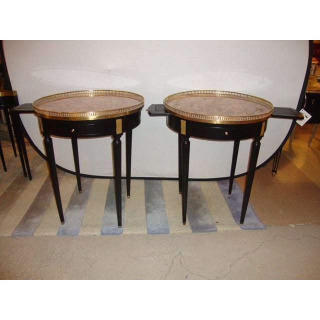 Pair of Maison Jansen Bouillotte or end tables. These finely constructed Bouillotte or end tables each have a pierced...
