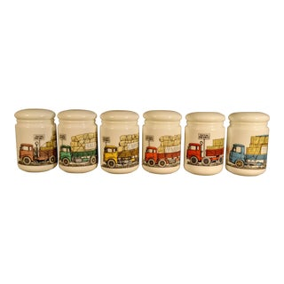 Set of Piero Fornasetti Opaque White Glass Jars and Covers made for Fiat, Circa 1960.