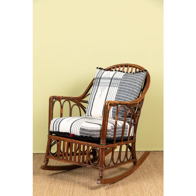 Classic East Coast Americana rocking chair with cushions made of Injiri organic cotton textiles from India. Textile has...