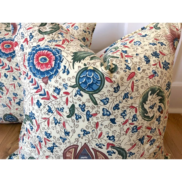 Pair of custom made pillows in Pierre Frey Fleurs Enchantees fabric. Backs are a neutral velvet fabric, trimmed in self...