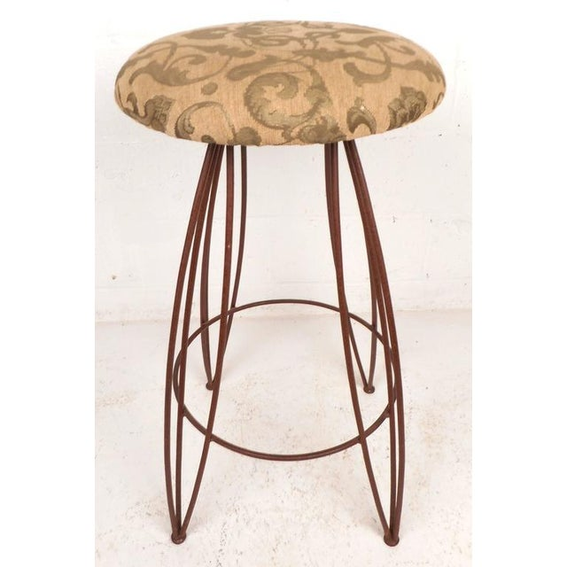 Beautiful set of three vintage modern bar stools feature a comfortable round upholstered seat on top of a sturdy wrought...