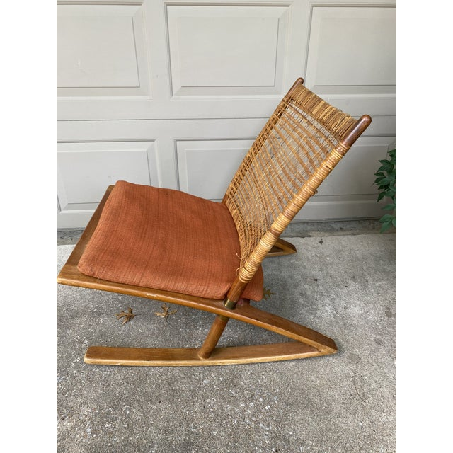 Norwegian rocking chair designed by Fredrik Kayser for Vatne Mobler, 1950s. Teak frame with brass accents, woven cane...
