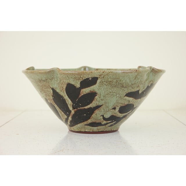 This unique hand made glazed ceramic bowl will bring a nice organic touch to the room it inhabits. This piece is in...
