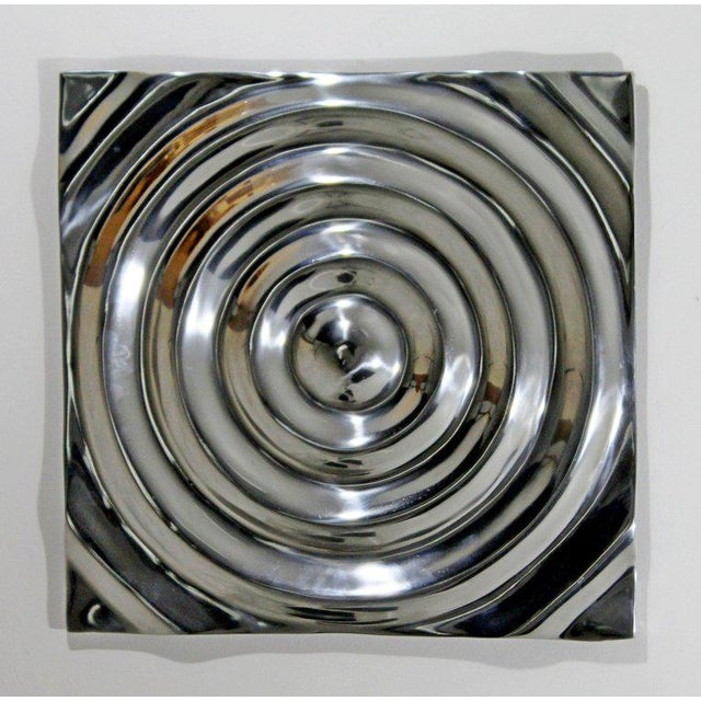 For your consideration is a fabulous, cast aluminium metal wall art, reminiscent of Saturn's rings, circa 1970s. In...